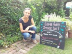 Volunteer with updated SACV chalkboard