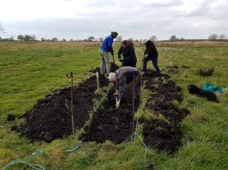 Volunteers working on a berm
