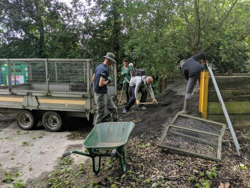 Volunteers shovelling