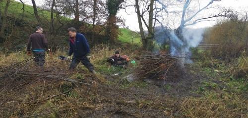 Volunteers getting bonfire started